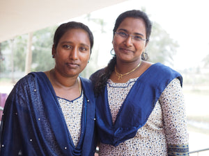 Two Indian women wearing blue ready to devote their lives to teach and educate children rescued from sex and labor trafficking