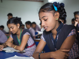 Indian girls in a classroom getting educated to better their lives after being trafficked