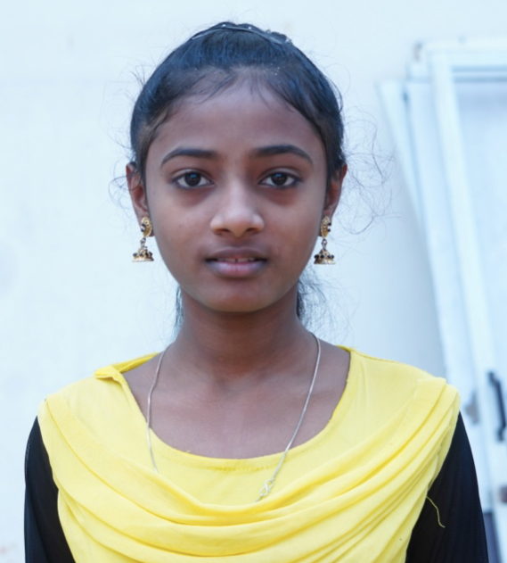 Little Indian girl rescued from slavery or human trafficking with a yellow shirt