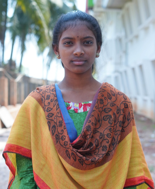 Little Indian girl rescued from slavery or human trafficking with a brown and yellow shawl