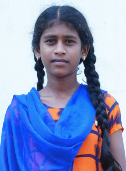 Little Indian girl with a blue and orange shirt rescued from slavery or human trafficking