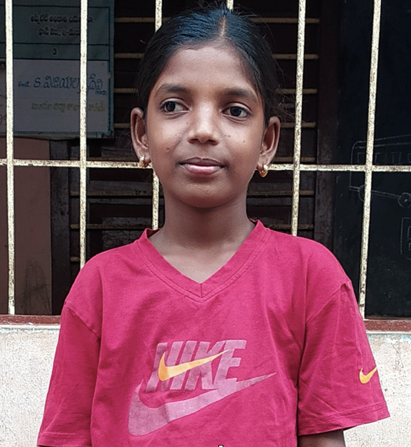 Female Indian child with a red shirt rescued from slavery or human trafficking