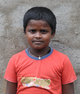 Male Indian child with a red shirt rescued from slavery or human trafficking