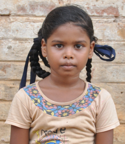 Little Indian girl with a tan shirt rescued from slavery or human trafficking