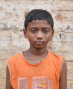 Little Indian boy with a orange shirt rescued from slavery or human trafficking
