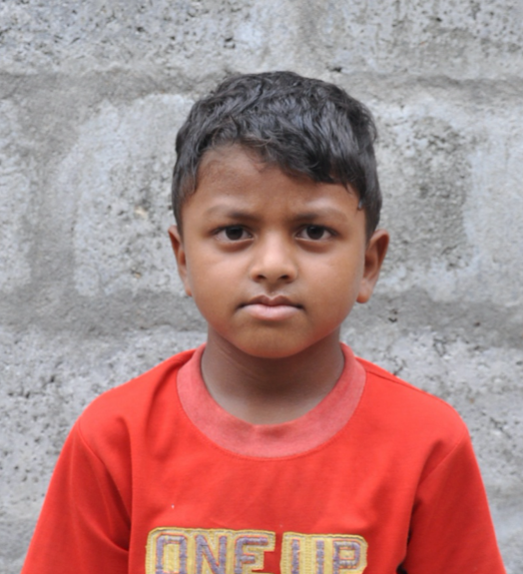 Little Indian boy with a red shirt rescued from slavery or human trafficking