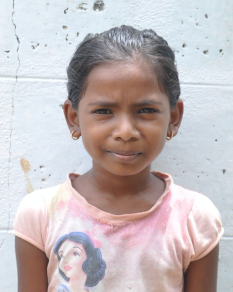 Little Indian girl with a pink shirt rescued from slavery or human trafficking