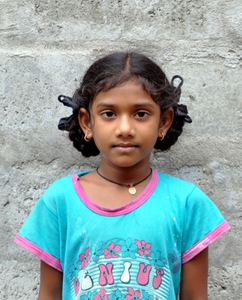 Little Indian girl with a light blue shirt rescued from slavery or human trafficking