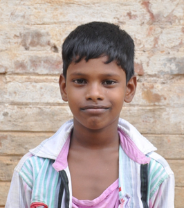 Little Indian boy with a white polo rescued from slavery or human trafficking