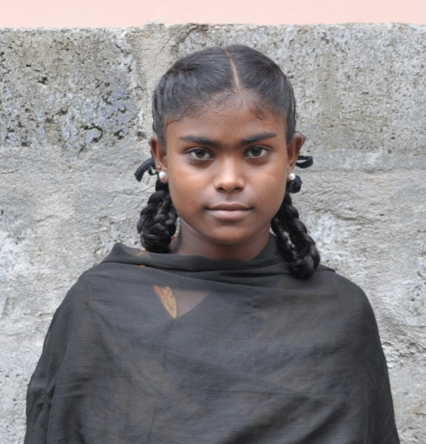 Little Indian girl with a black shirt rescued from slavery or human trafficking