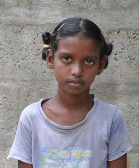 Little Indian girl with a grey shirt rescued from slavery or human trafficking