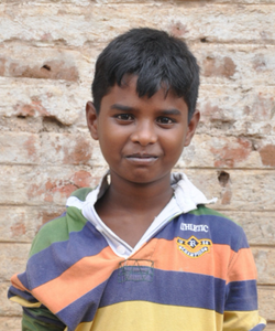 Little Indian boy with a striped polo rescued from slavery or human trafficking