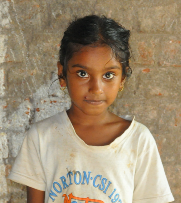 Little Indian girl with a white shirt rescued from slavery or human trafficking