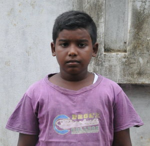 Little Indian boy with a purple shirt rescued from slavery or human trafficking