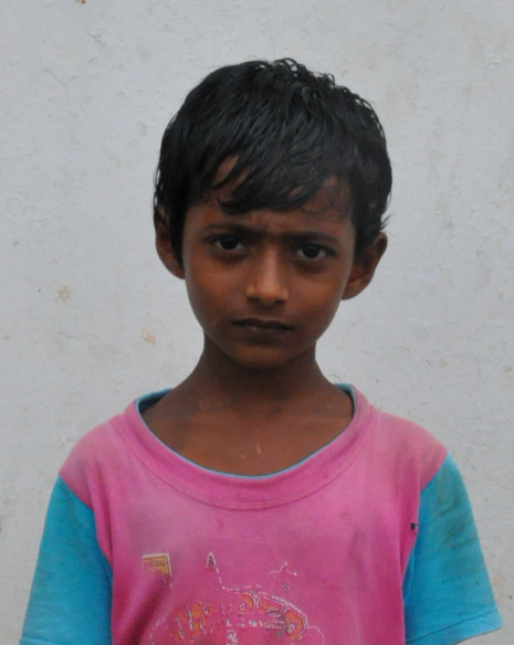 Little Indian boy with a pink shirt rescued from slavery or human trafficking