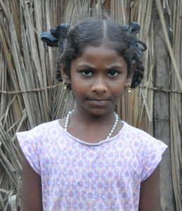 Female Indian child with a white shirt rescued from slavery or human trafficking