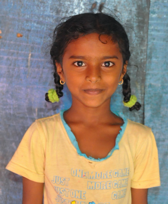 Little Indian girl with a yellow shirt rescued from slavery or human trafficking