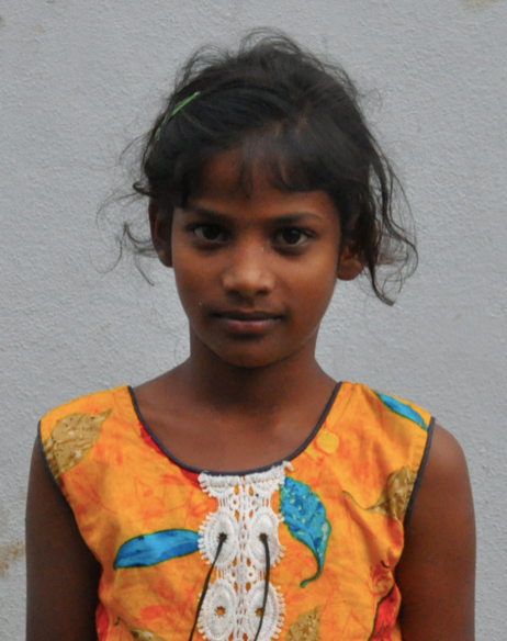 Little Indian girl with a orange shirt rescued from slavery or human trafficking