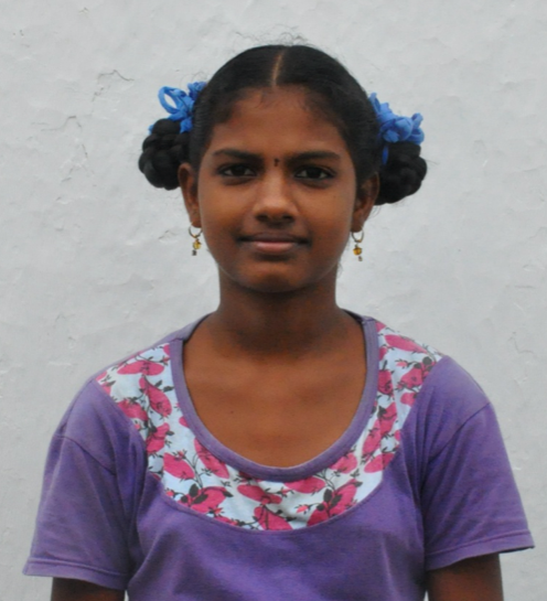Little Indian girl with a purple shirt rescued from slavery or human trafficking