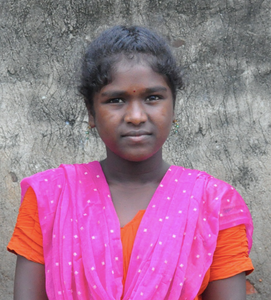 Female Indian child with a orange shirt and shawl rescued from slavery or human trafficking