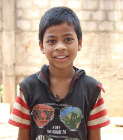 Little Indian boy with a black hoodie rescued from slavery or human trafficking
