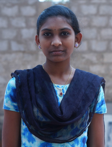 Little Indian girl rescued from slavery or human trafficking with a light blue shirt