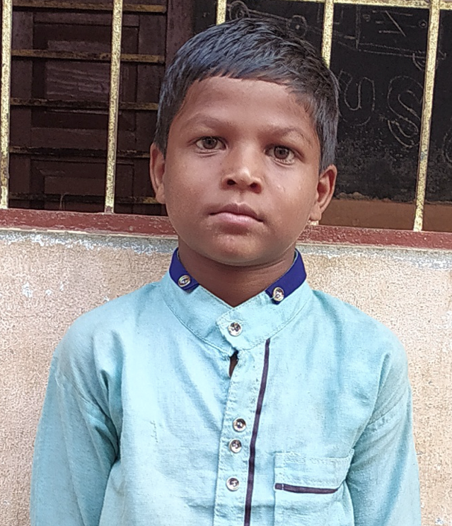 Little Indian boy with a light blue shirt rescued from slavery or human trafficking