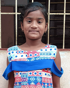 Little Indian girl with a blue shirt rescued from slavery or human trafficking