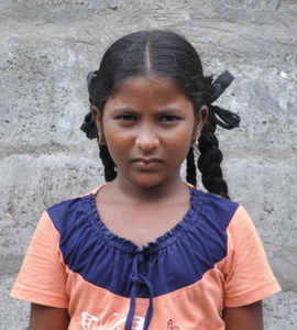 Little Indian girl with a pink and blue shirt rescued from slavery or human trafficking