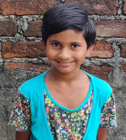 Female Indian child with a blue shirt rescued from slavery or human trafficking