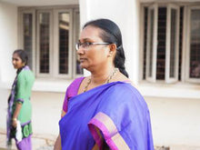 Load image into Gallery viewer, An Indian woman wearing pink. The teachers are ready to devote their lives to teach and educate children rescued from human trafficking