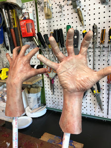 Pair of male hands with fingers spread