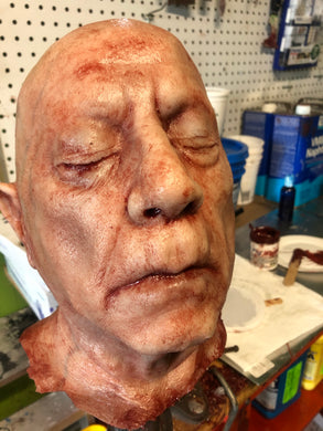 Severed old man head