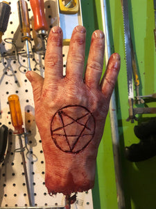 Severed male hand with pentagram