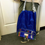Easy clean expandable, convertible clutch-to-tote--great for travel