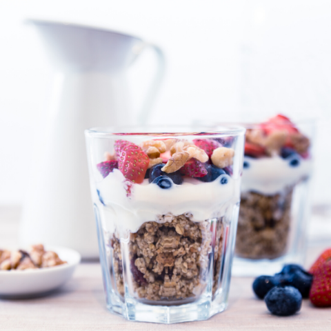 Granola parfait with berries in glassware Top New Years resolution bulk up breakfast