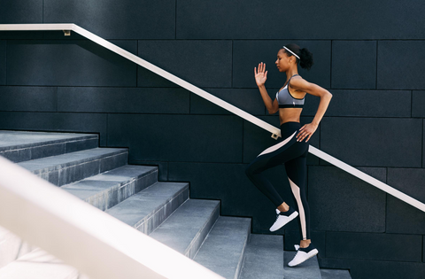 Woman-running-stairs-to-boost-energy-naturally-natureal