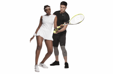 Black-female-tennis-player-white-male-instructor-exercise-