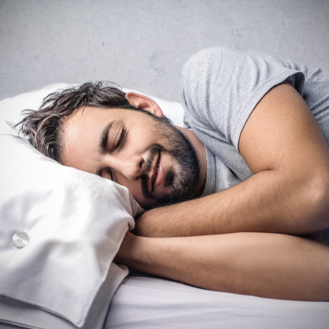 Bearded Male sleeping in grey shirt health and fitness new year's resolutions