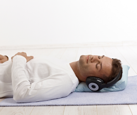 Man-headphones-yogamat-reduced-stress-anxiety-self-care