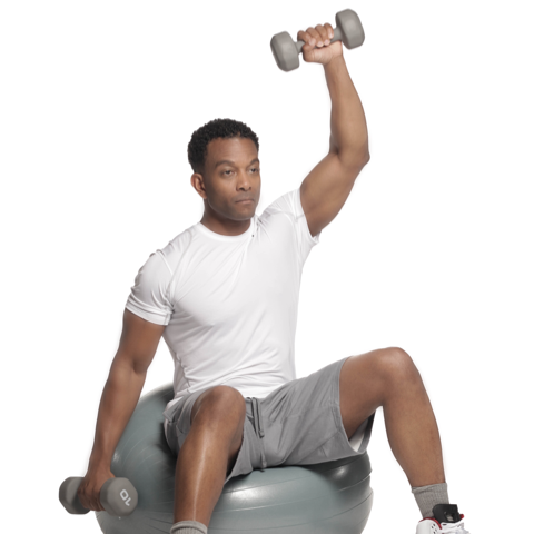 African American male lifting dumbbells on mobility ball. Health and fitness new year's resolutions.
