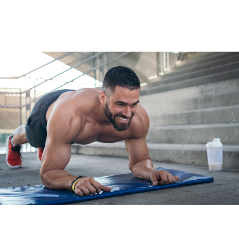 Thе Top 26 Health аnd Fіtnеѕѕ Nеw Year's Rеѕоlutіоnѕ fоr 2020, shirtless man doing planks outdoors on blue workout mat.