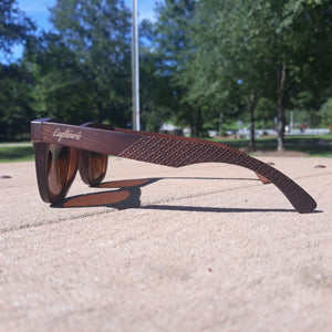 ebony wooden sunglasses side view outdoors