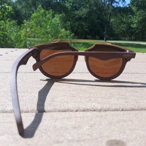 cherry wood and acetate sunglasses outdoors