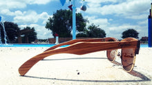 Load image into Gallery viewer, zebrawood sunglasses with brown lens by pool