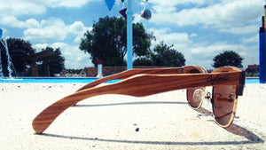 zebrawood sunglasses with brown lens by pool
