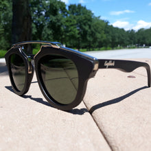 Load image into Gallery viewer, black wood with silver metal frame sunglasses outdoors