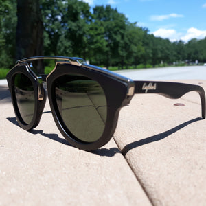 black wood with silver metal frame sunglasses in the sun