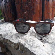 Load image into Gallery viewer, red stripe bamboo sunglasses front view outside