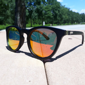 outdoors view of red lens sunglasses